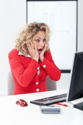 woman-shocked-computer